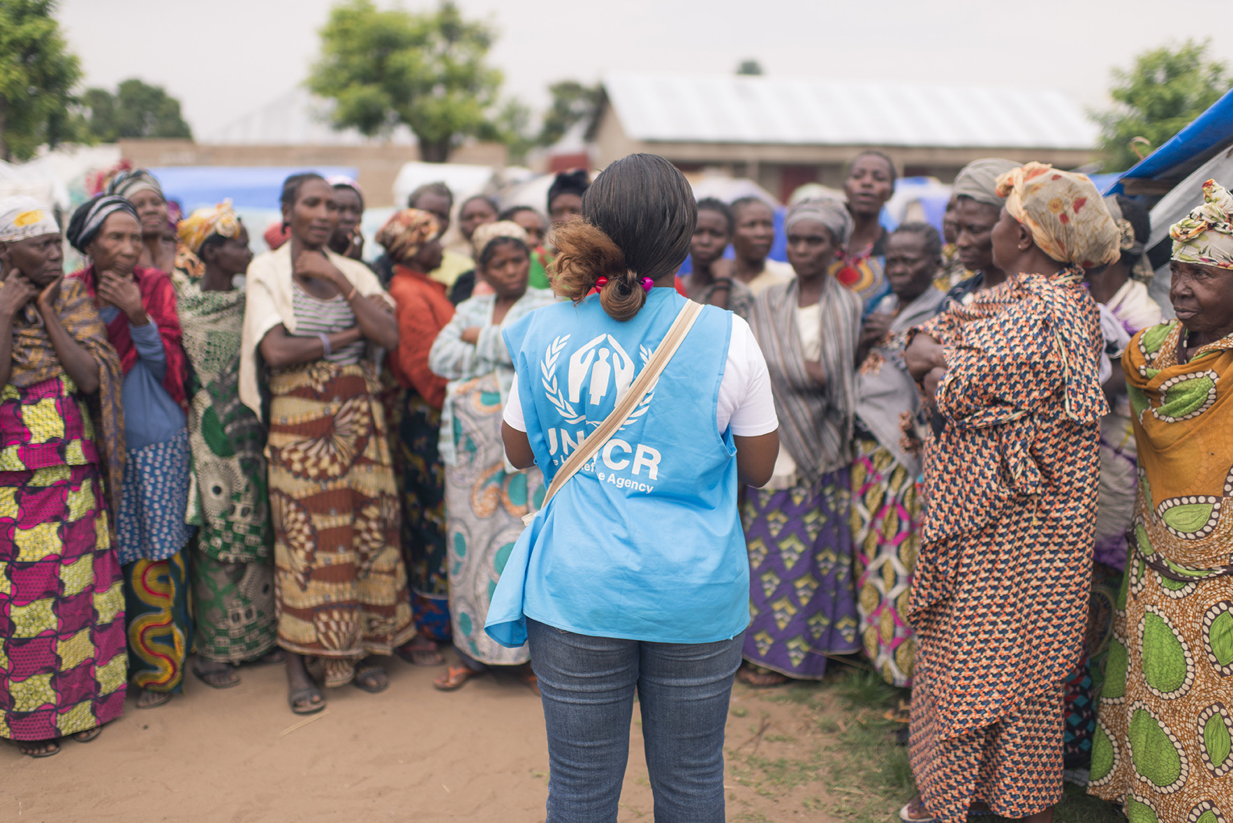 A UNHCR field staff in Kalemie, is gathering IDPs to talk about abducted children in E.P. Moni site, Tanganika province. ; The Democratic Republic of Congo's Tanganyika Province has experienced massive internal displacement, caused by inter-ethnic conflict and fighting between armed groups and the Army.  As of 30 November 2017, over 700,000 people were internally displaced in the province. The displaced often lived in makeshift sites or public buildings such as schools, receiving very little humanitarian aid.